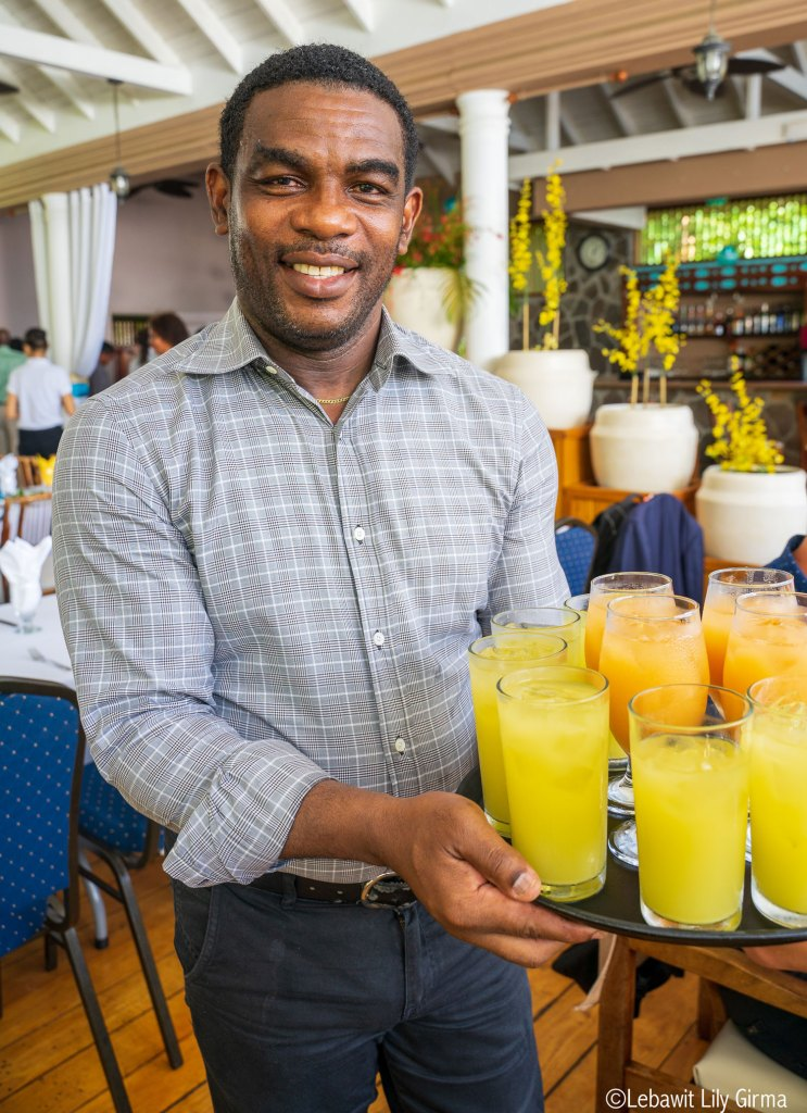 Waiter at Beachcombers Hotel holding a tray of drinks