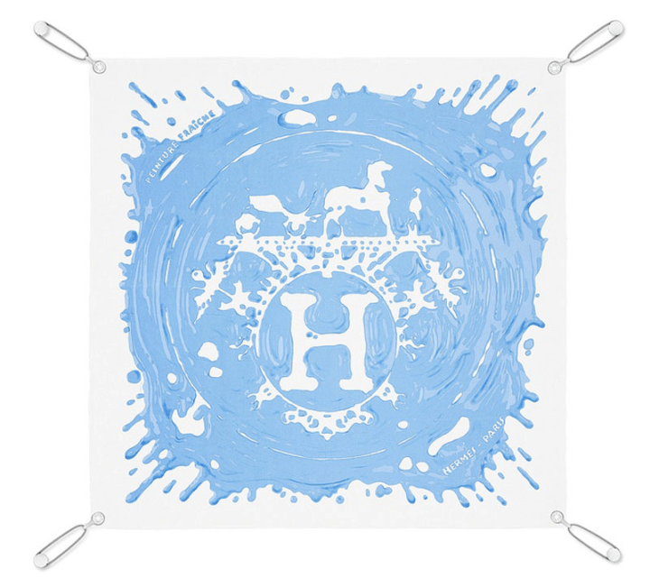 Hermes scarf on a scarf display system.