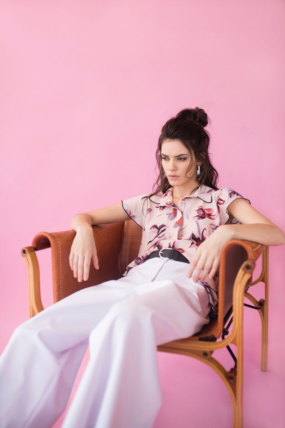 photography-of-a-woman-sitting-on-chair-1070030