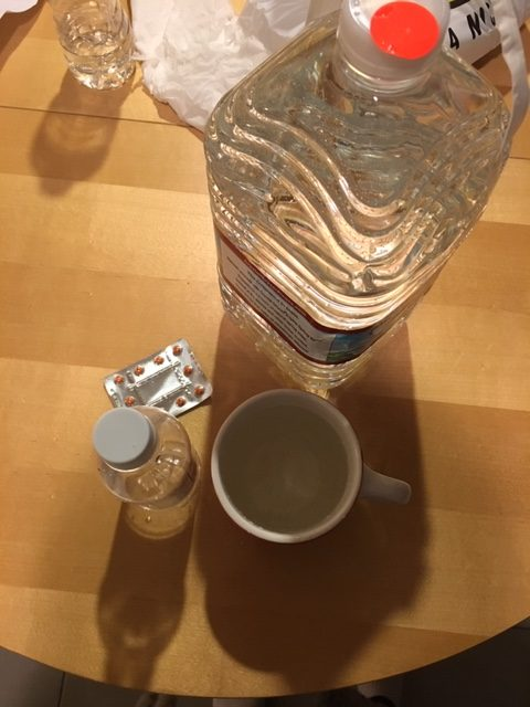A gallon of water, a sleeve of Dulcolax tablets, and saline laxative in preparation for a colonoscopy