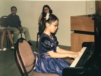 A Chinese girl playing the piano