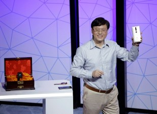 Lenovo Chairman and CEO Yuanqing Yang holds up the new Phab2 Pro phone during the keynote address at the Lenovo Tech World event, Thursday, June 9, 2016, in San Francisco. The Lenovo smartphone unveiled Thursday will be clever enough to grasp your physical surroundings, such as the room's size and the presence of other people, and potentially transform how we interact with e-commerce, education and gaming. Tapping Google's 3-year-old Project Tango, the new phone will use software and sensors to track motions and map building interiors, including the location of doors and windows. (AP Photo/Eric Risberg)