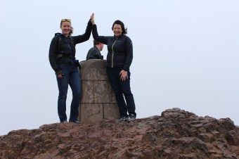 We made it to the top of Arthur's Seat (and some oblivious guy decided to walk into our photo...)