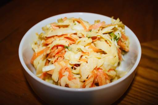 Creamy Coleslaw in a white bowl.