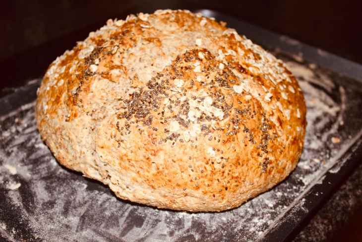 Traditional Irish Soda Bread with Chia Seeds on a baking tray. Fresh out of the oven with a golden crust and soft bread inside.