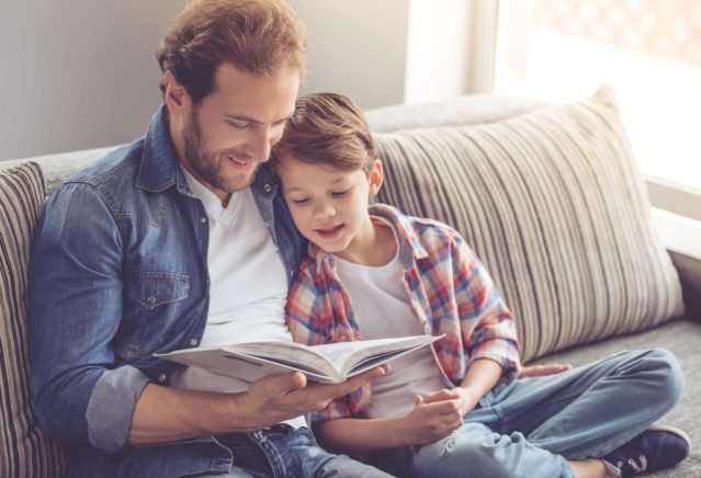 father reading to son, a way to help speech delays