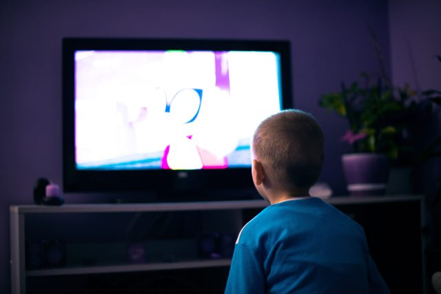 a child staring at a tv
