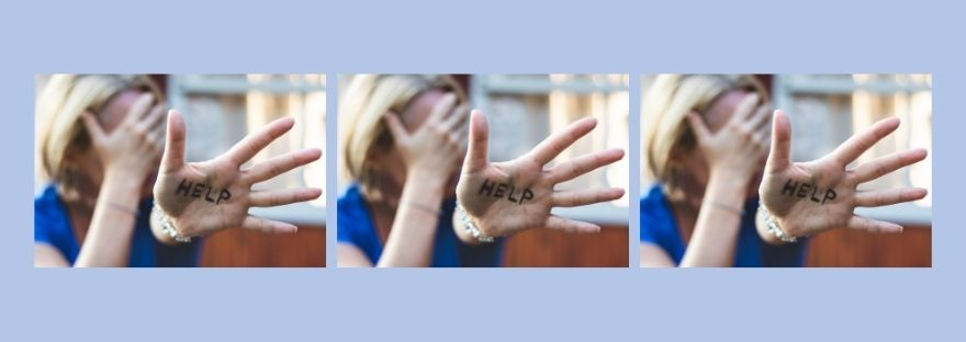 A womans hand with the word help written on it , rpeated three times