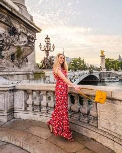 Woman standing in Pont Alexandre III at sunset