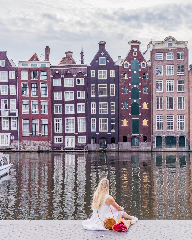Typical Dutch houses in Damrak in Amsterdam - the Netherlands