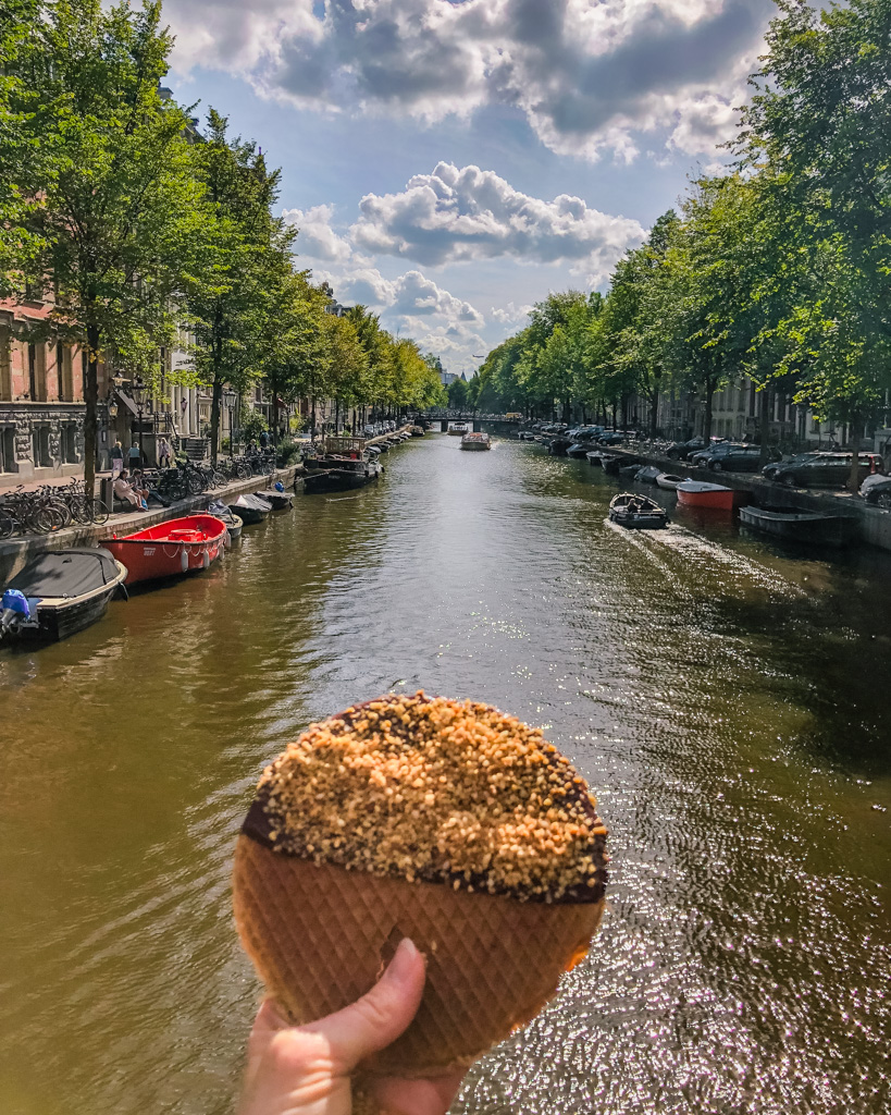 Stroopwaffel in front of the canal in Amsterdam - The Netherlands