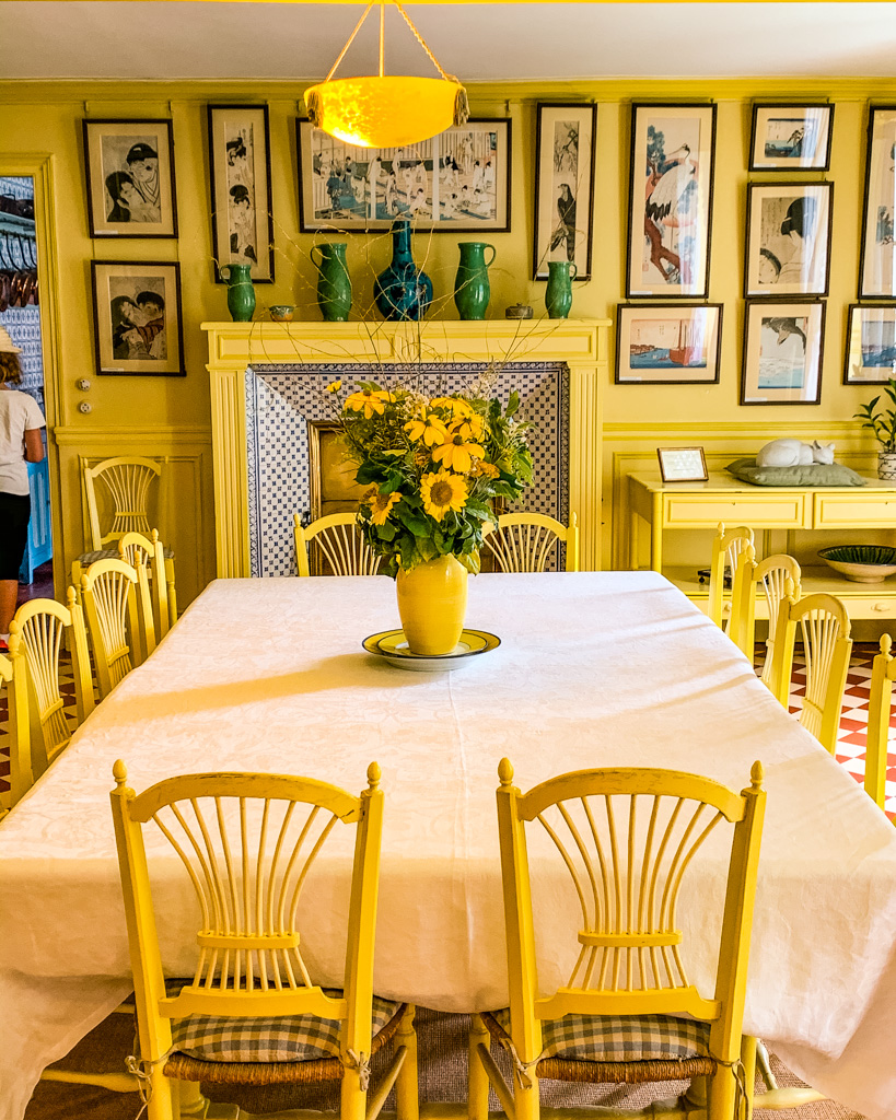 Yellow dining room inside Monet's house in Giverny