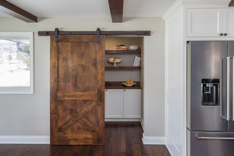 Unused side entry converted to barn door pantry