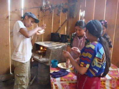 tourist & girls making tortillas (av)