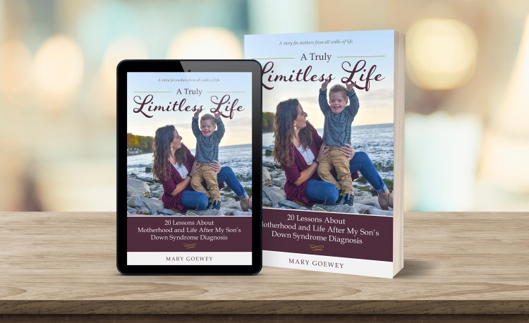 A Photograph of the book and ebooks, which include the author (mother) with her son on the shore of a lake.