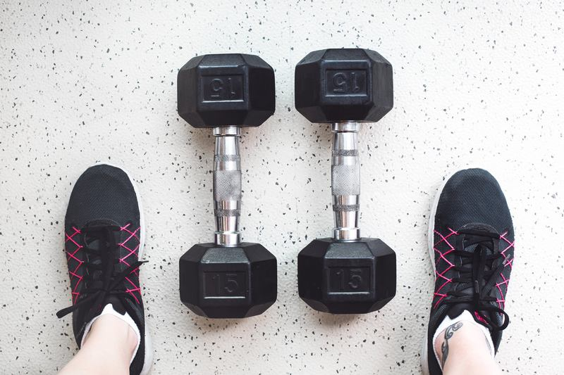 dumbbells and gym shoes - 10 Best Home Exercise Equipment For Weight Loss