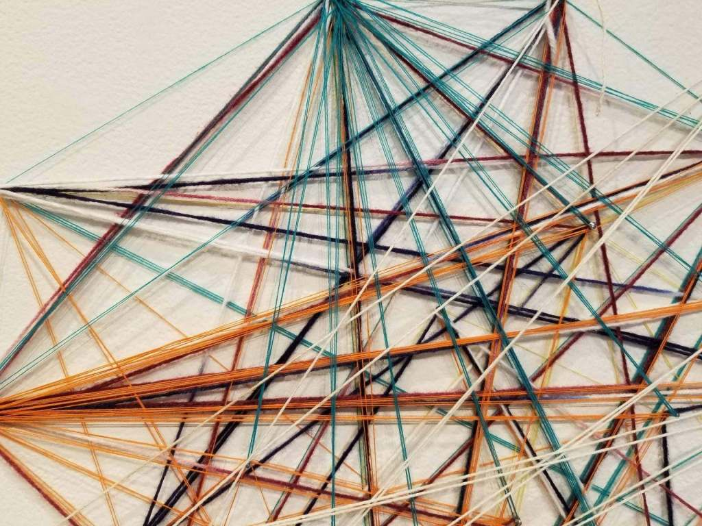 Colorful thread is displayed in this abstract art piece
