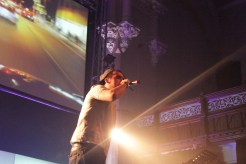 MC Breaker on stage, performing to the crowd during his rapping.