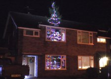 Inventor squeezes 26ft Christmas tree in 18ft house