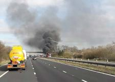 Car transporter catches fire causing M180 delays