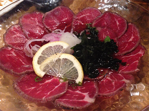 Beef Tataki - seared beef, fresh grated daikon, red onion and green onion with ponzu & sesame dressing - $12.95