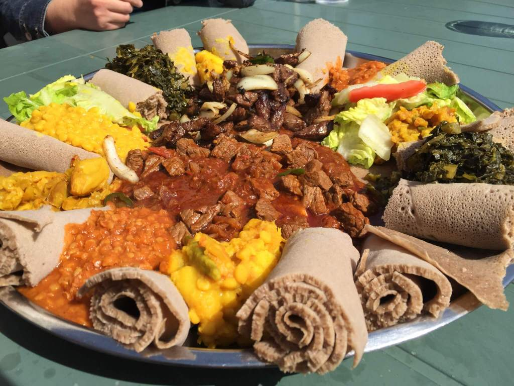 Veggie Platter ($15), Beef Chacha Beef Entree ($17) and Yebeg Tibs Lamb Entree ($17) at Abyssinia Ethiopian Restaurant.