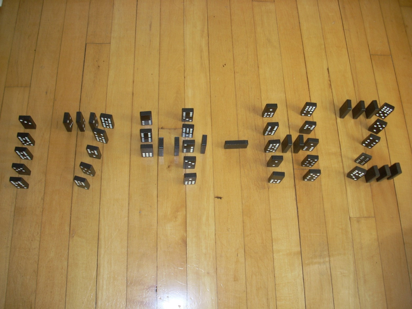 photo of standing dominoes spelling 174 - HZ which is the frequency to alleviate pain