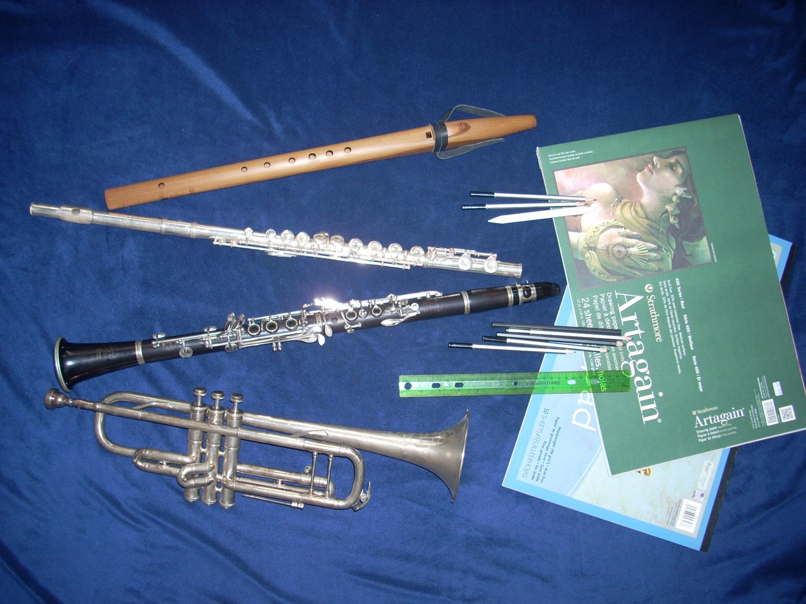 Creative Problem Solving is possible withA Native American flute, and the traditional instruments: flute, clarinet and trumpet as well as sketch pads and drawing supplies are pictured.