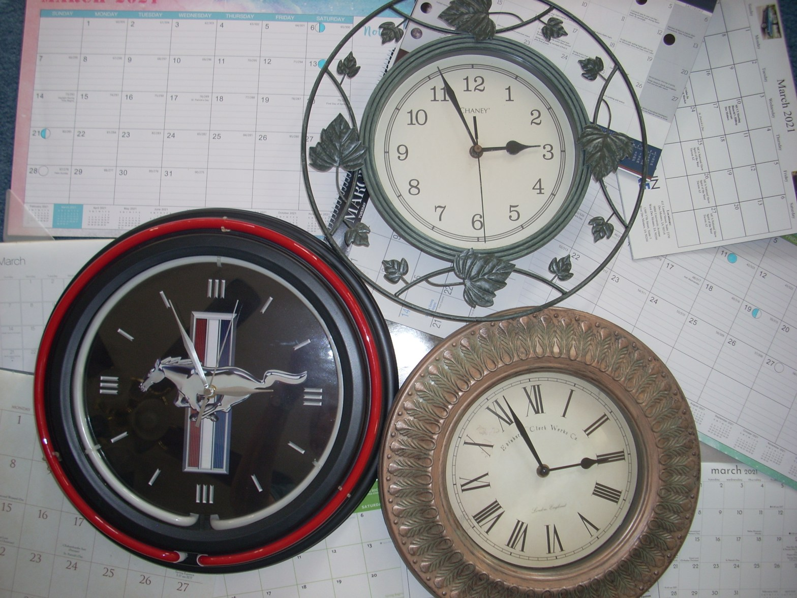 photo of various clocks and calendars