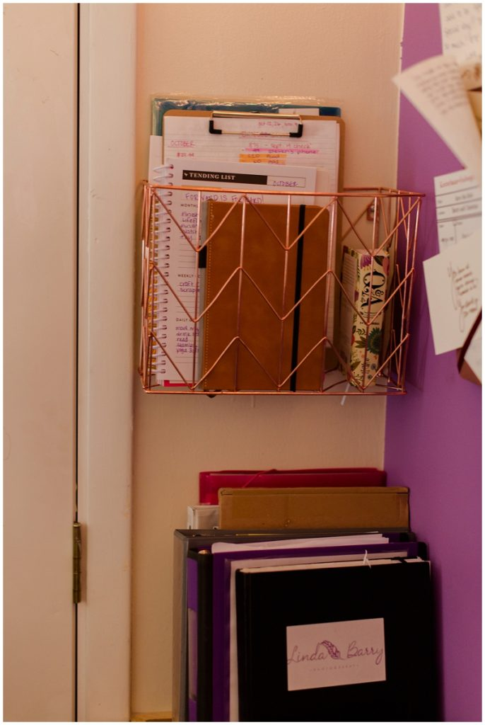 Office inspiration for a clean, simple, and tidy home office. Click here to see more by Linda Barry Photography! Copper wire basket to organize papers and notebooks.