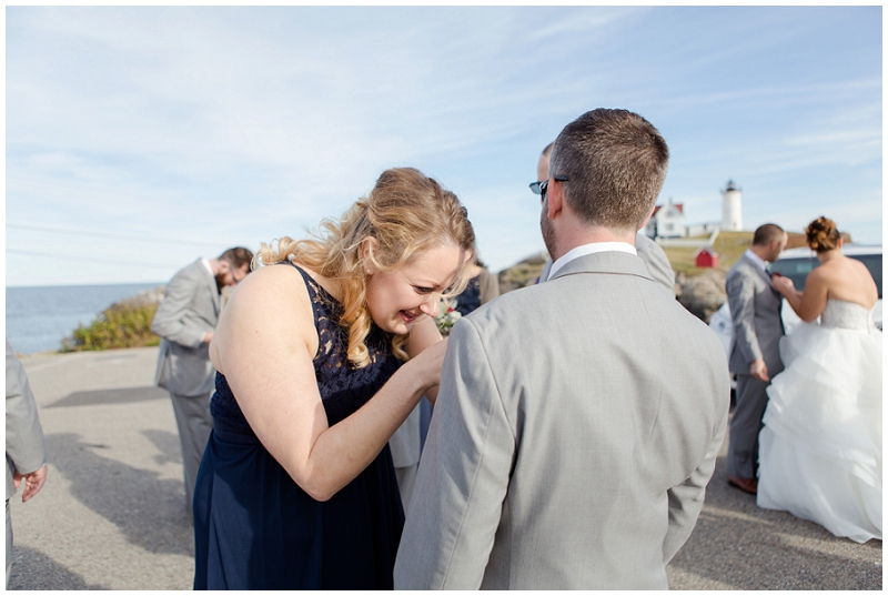 Melanie and Mike were married at Clay Hill Farm in Cape Neddick Maine. Click here to see more beautiful photos by Linda Barry Photography of their burgandy and navy wedding day! Wedding party at Nubble Lighthouse.