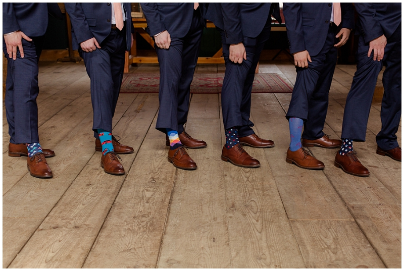Emily and Nick were married at Stone Mountain Arts Center. Click here to see more wedding images by Linda Barry Photography. Groomsmen socks.