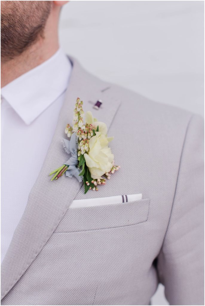Groom detail photo of boutonniere and pocket square. Photo by Linda Barry Photography, a Boston based wedding photographer.