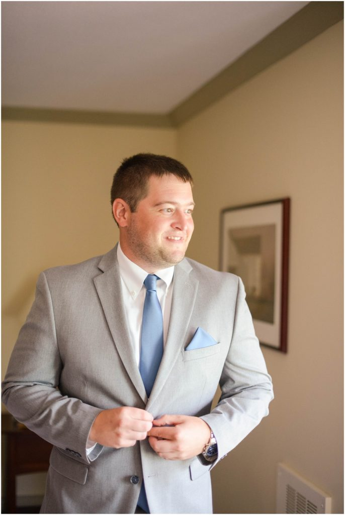 Handsome groom getting ready for his Atkinson Resort Wedding day! Photos by Linda Barry.