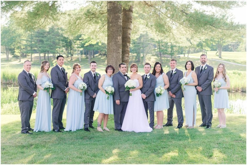 Full wedding party portraits from this summer wedding at the woodlands club.