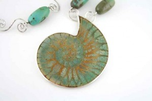 Turquoise-Fossil-with-Turquoise-beads-and-Coil-Links
