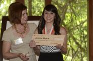 Dr. Glessner presents a check to Jessica Reyna at the 2012 Exemplary Migrant Student Recognition Ceremony.