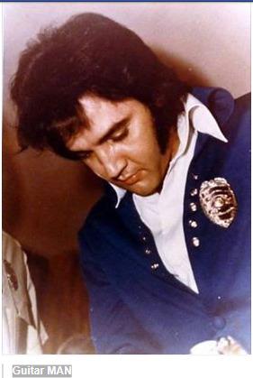 Elvis wearing badge (Lisa on FB)Guitar MAN