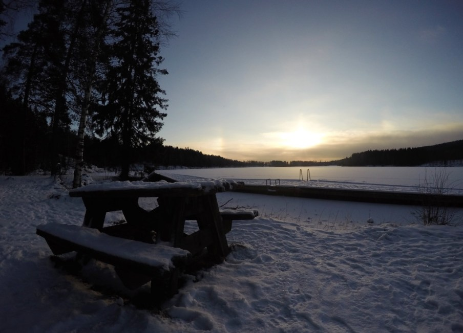 Picnic bench at Sognsvann, covered in snow and ice.
