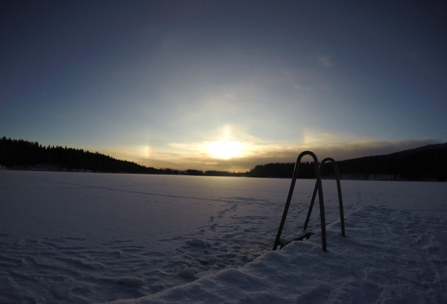 Sognsvann, Oslo during winter. The ladder goes into the frozen lake.