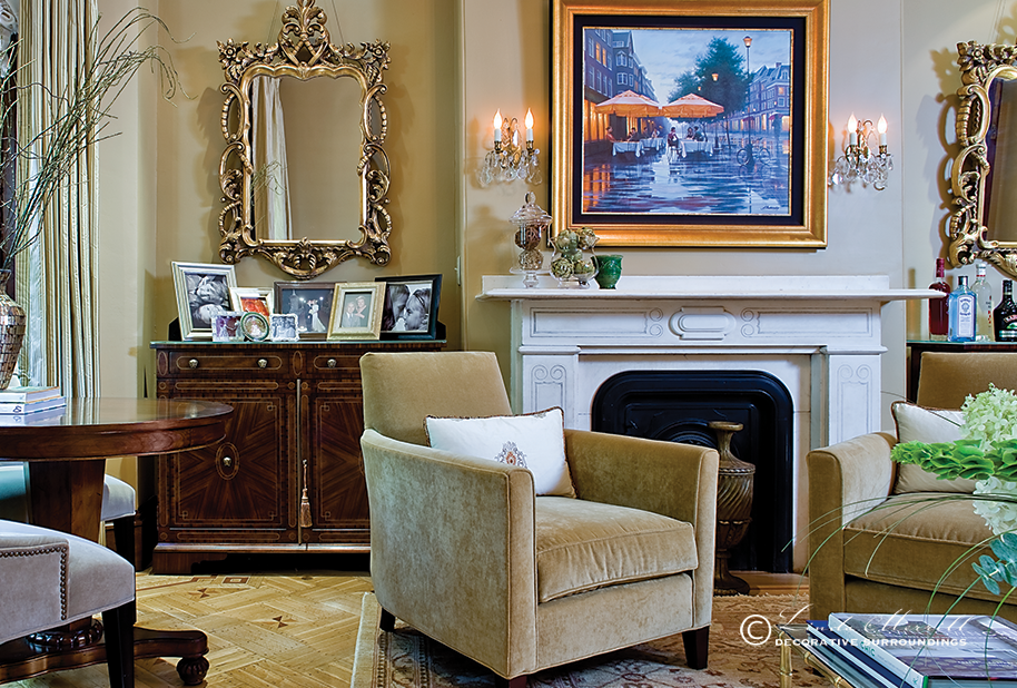 A formal gold living room in a Boston townhouse filled with velvet chairs, fireplace, antique chandelier Interior design and decorating services