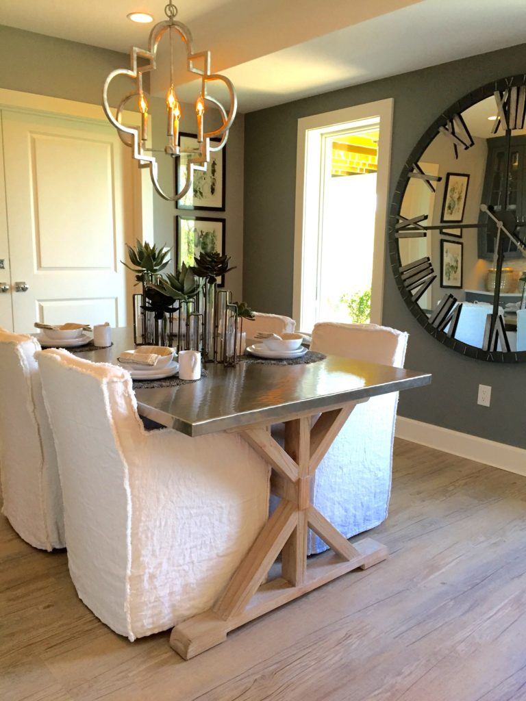 2016 Boston Magazine Design Home at The Pinehills Plymouth MA dining white chairs, stainless table