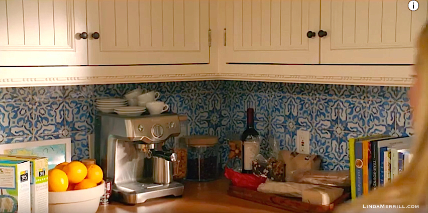 Home Again movie kitchen with blue backsplash and off-white cabinets
