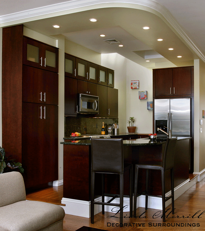Design by Linda Merrill Decorative Surroundings: Back Bay Bachelor Penthouse kitchen with dark cherry cabinets, brown leather counter stools