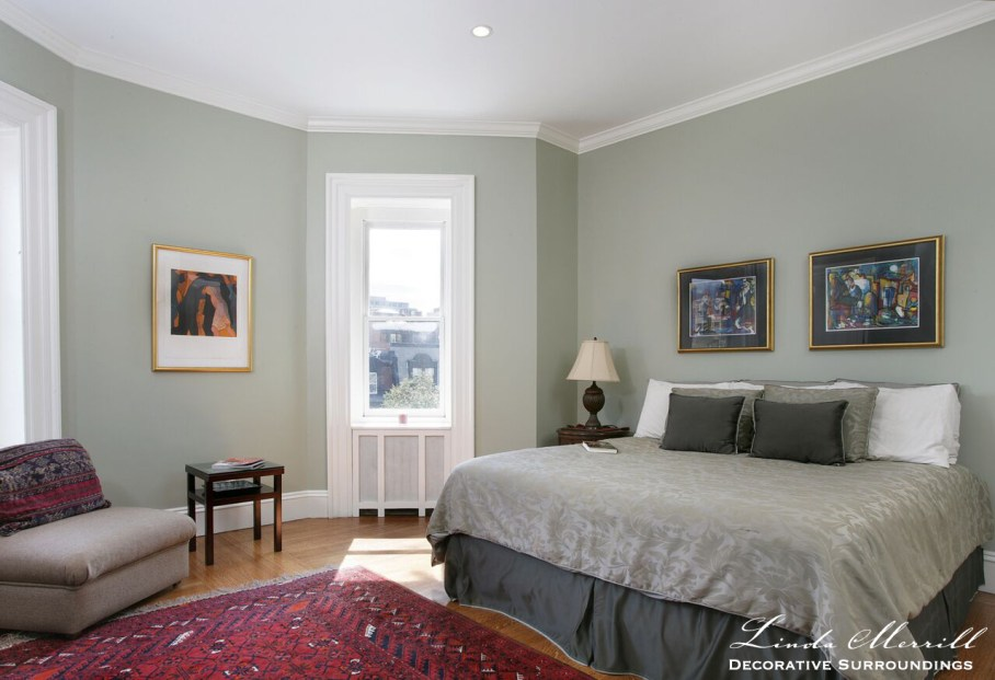 Back Bay Bachelor Penthouse bedroom with gray walls and bedding, red oriental carpet