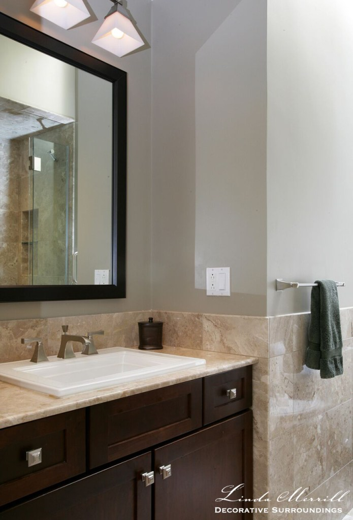 Back Bay Bachelor Penthouse bathroom with Kohler Memoires collection sink, cherry cabinets, marble tile.