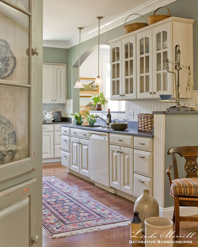 Coastal Home kitchen in Duxbury MA white cabinets headboard cabinet oriental carpet antiques baskets