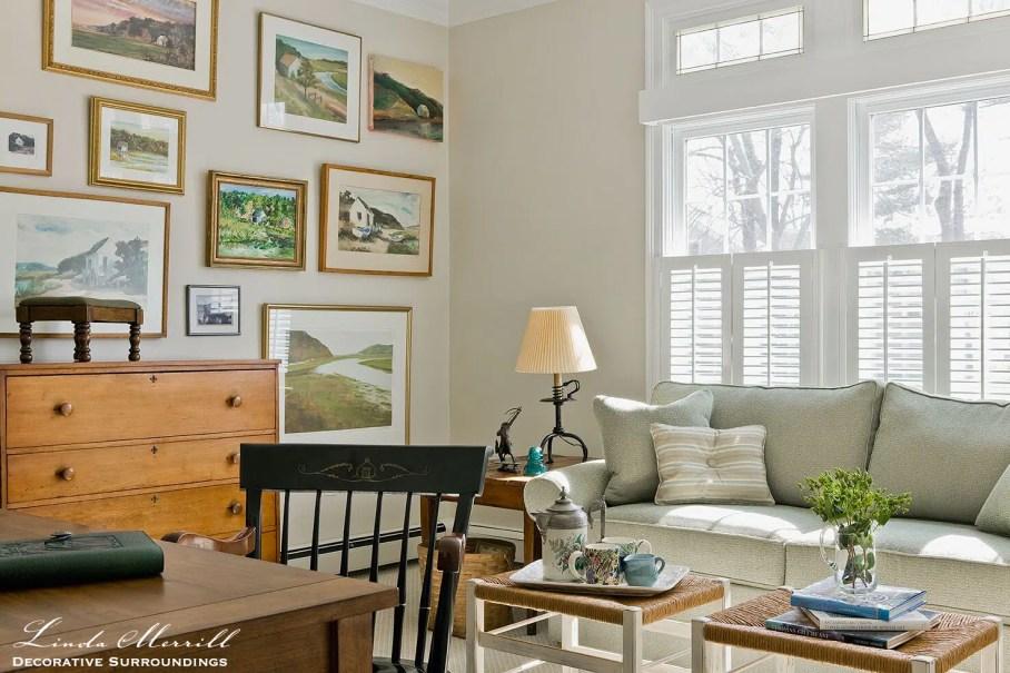 Coastal Home den in Duxbury MA with green sofa, fine art gallery wall
