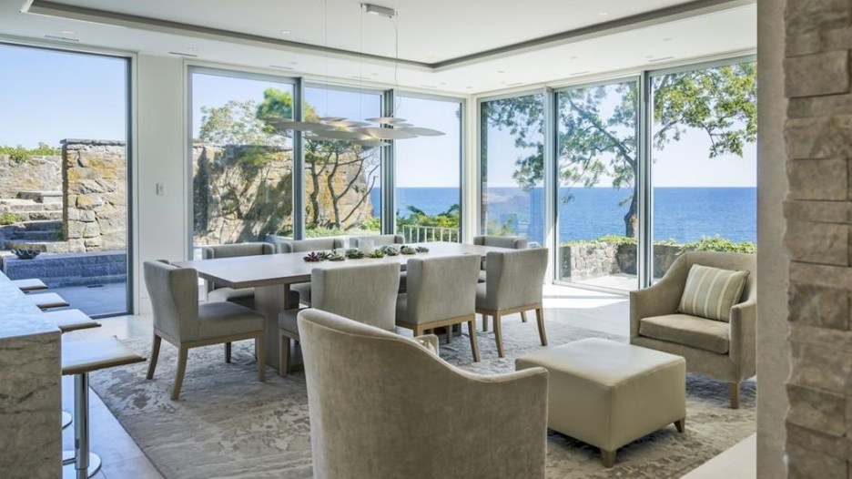 Spectacular oceanside modern beach house in Manchester-By-The-Sea Massachusetts. #modern #beach #coastal #home #oceanside #views #stone #glass #dining #room #diningroom