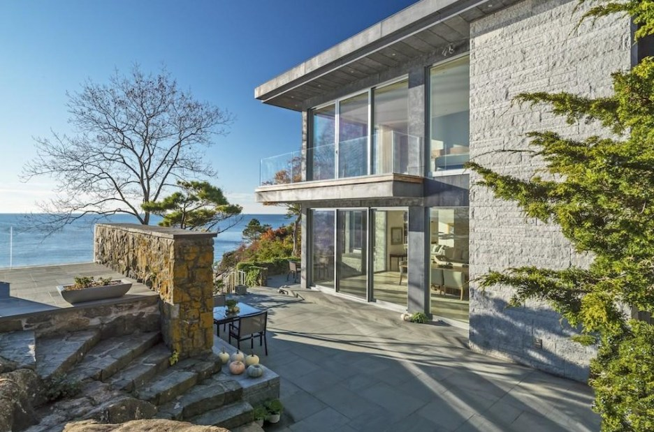 Spectacular oceanside modern beach house in Manchester-By-The-Sea Massachusetts. #modern #beach #coastal #home #oceanside #views #stone #glass #exterior #windows #patior